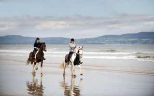 Students Horse Riding on an Irish Beach