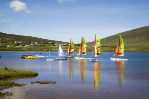 Boats Sailing Across an Irish Lake